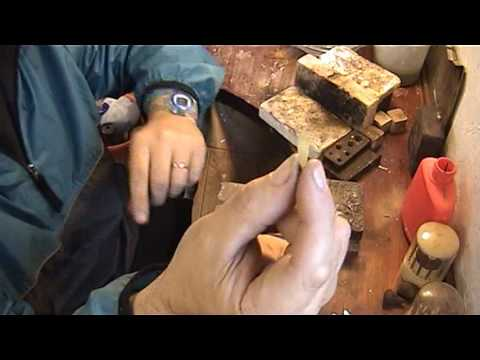 goldsmith at work repairing jewellery video 3