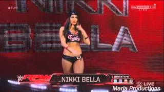 Nikki Bella enters the arena with Brock Lesnar
