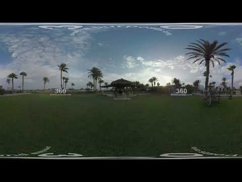 360 VR Rustic style outdoor cafe on seafront, view at sunset. Tunisia