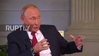 Russia: 'Can I finish what I'm saying?' - Putin switches to German to shoot down interrupting journo