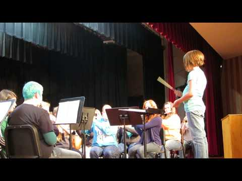 """Third grader Emma W. """"conducts"""" the Laker High School band"""