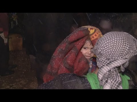 Thousands wait in the snow to be evacuated from Aleppo