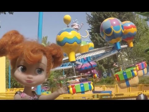 Theme park fun! Elsa and Anna toddlers have fun & enjoy the amusement rides  PART2