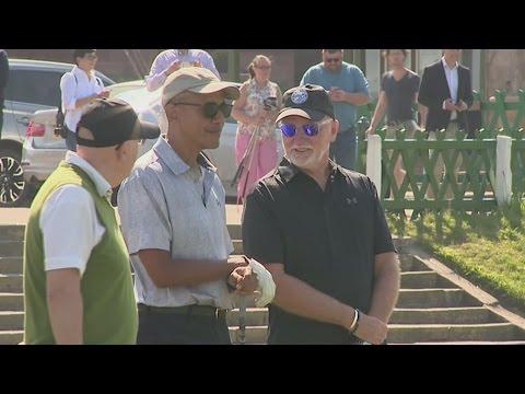 Barack Obama plays golf at St Andrews on Scottish visit