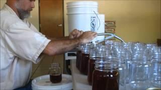 handy filler piston pump filling honey jars at harmony hollow honey