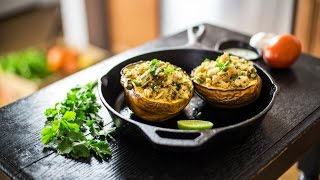 Stuffed Acorn Squash With Cucumber Yogurt Sauce.