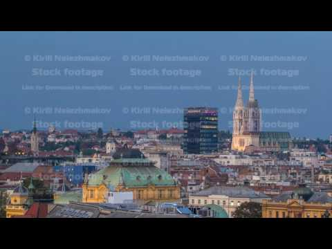 Zagreb capitol of Croatia cathedral and modern skyscraper with a old city panorama day to night