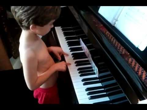 Autistic Child Plays Piano (Unedited-wait for it)