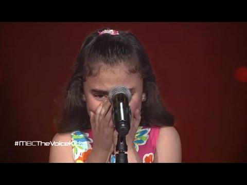 Syrian child cries singing