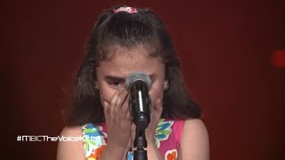 Syrian child cries singing