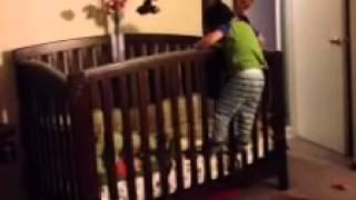 Toddler Climbs Into His Crib