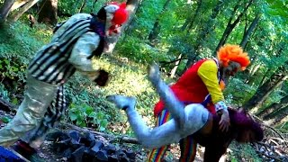 creepy clowns beat up kid in the woods