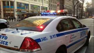 NYPD OFFICERS ARREST MOTORIST AFTER ALLEGEDLY FIGHTING WITH PEDESTRIAN ON WESTSIDE OF NEW YORK CITY.