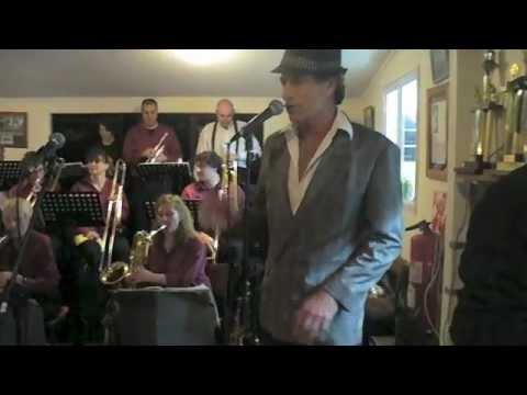 Mike Murane singing at the Piha Bowling Club