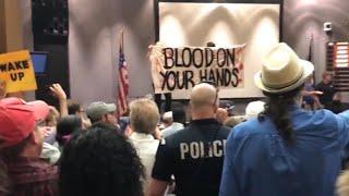 Angry protestors at Charlottesville City Council meeting