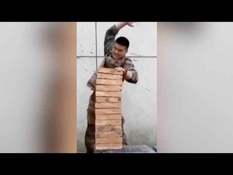 Military officer breaks 14 bricks using his hand