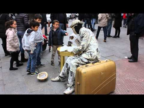 Madrid - Street artist reads Newspaper and drinks coffee (HD)