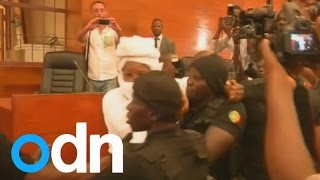 Former Chad President Hissene Habre removed from court at the start of his trial for war crimes