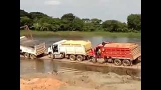 Trucks Fall Off Barge Into River