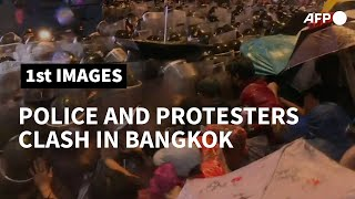 Thailand: Police and protesters clash, water cannon used | AFP
