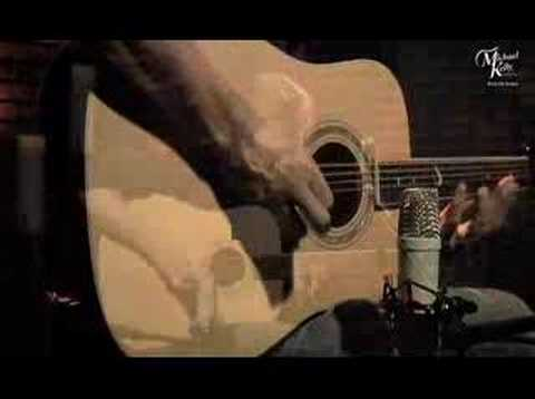 Ellis Paul plays a Michael Kelly V65 Acoustic