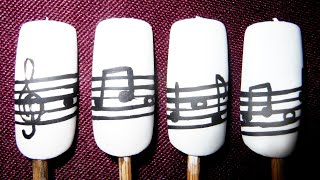 Classic black and white musical notes nail art