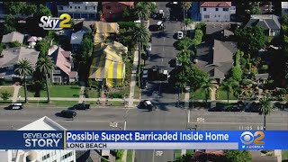 Police In Standoff With Possible Burglary Suspect In Side Tented Long Beach Home