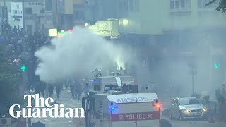 Hong Kong police use water cannon as protesters throw petrol bombs