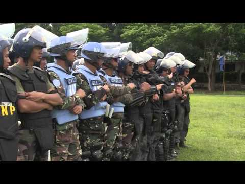 Philippine National Police and US Marines Perform Crowd Control Formation