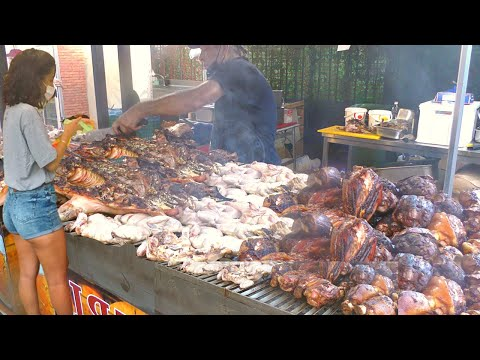 Italy Street Food. Biggest Whole Bull Roasted, Pork Knuckles, Mixed Meat on Grill, Sausages