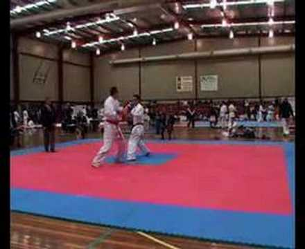 Jump kick knockdown in karate competition - YouTube