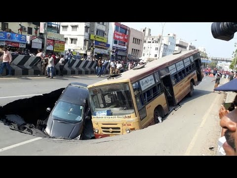 Road on Chennai's Anna Salai caves in pulling down bus, car