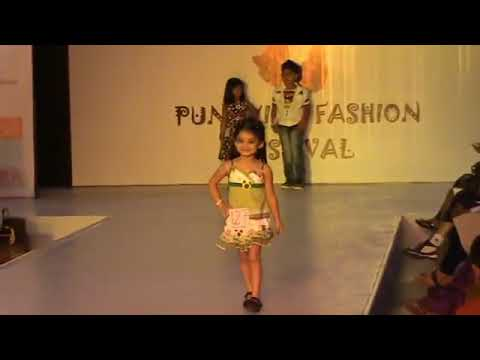 CUTE AND SMALL GIRL RAMP WALK AT KIDS FASHION SHOW