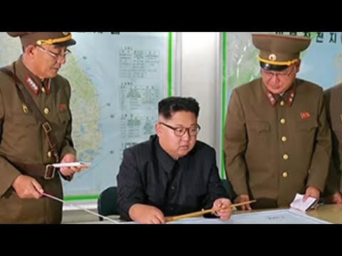 North Korea holds off on Guam missile plan