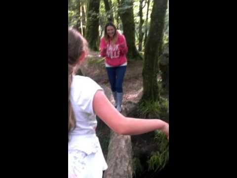 Stunt women conquers log