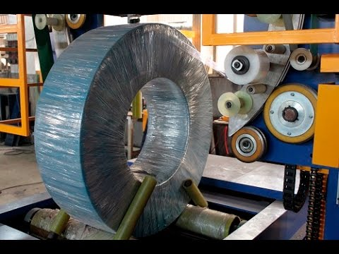 Coil wrapping machine with stretch film and woven