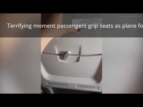 Terrifying Moment Passengers Grip Seats As Plane Forced To Land