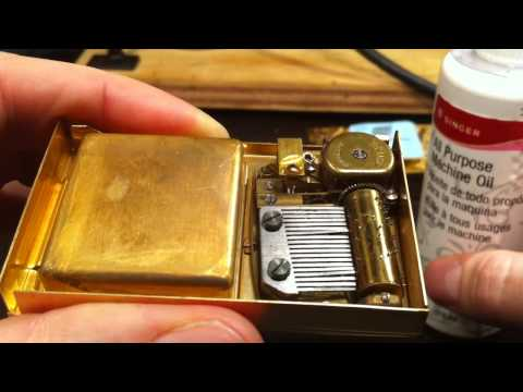 Fixing a 50 year old music box inside a compact