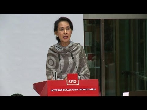Suu Kyi cautions Myanmar 'not yet a democracy'