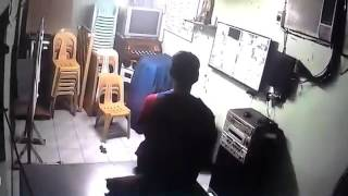 Chair rotating and moving on its own seen on CCTV footage