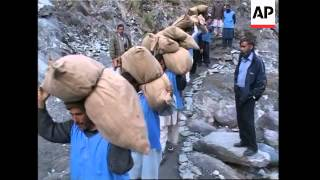 Snow on mountain, quake survivors, relief moved along LoC