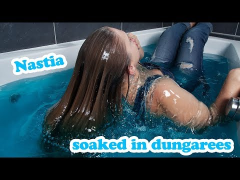 Nastia soaked in dungarees