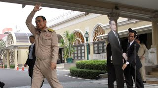 Thai PM leaves cardboard cutout to take questions from the media