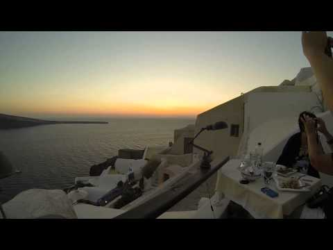 Beautiful Sunset Dinner in Greek Village of Oia on the Island of Santorini