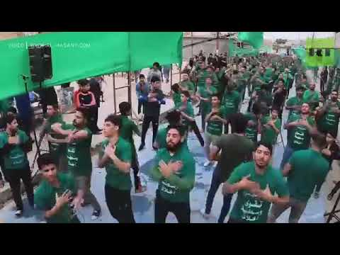 Shi'ite Muslims rap religious texts to reach youth تقرير قناة روسيا اليوم باللغة الأنكليزية