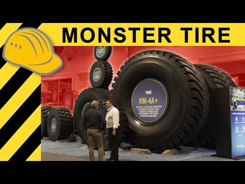 BIGGEST TIRE IN THE WORLD - $50,000 EXTREME MINING Tire Explained at MINExpo 2016  4K