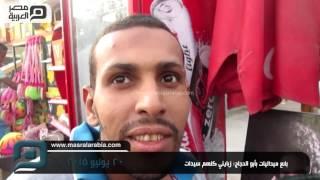 مصر العربية   بائع ميداليات بأبو الحجاج: زبايني كلهم سيدات
