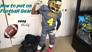 How to put on football gear  Football Swag  8U  Breast Cancer Awareness Edition