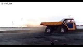 450 ton dump truck crushes car