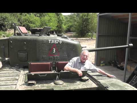 Guardsman Peter Brown from 6th Guards Tank Brigade reunited with  a Churchill Tank